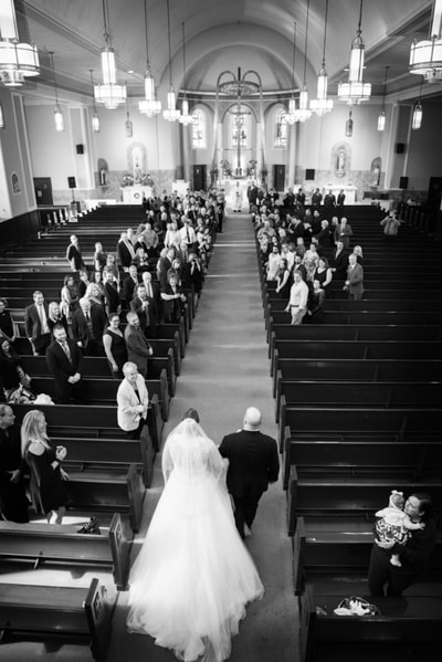 Bride and dad walking down aisle in church