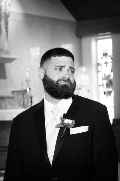 Grooms reaction to bride at church