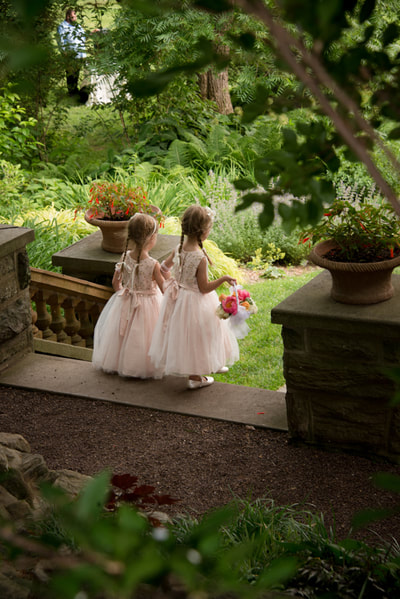 Outdoor wedding ceremony flower girls