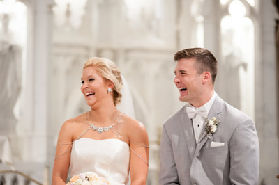 Bride and groom laughing church wedding