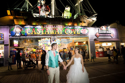 Bride and Groom on boardwalk at night