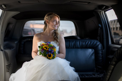 Bride in limo before wedding