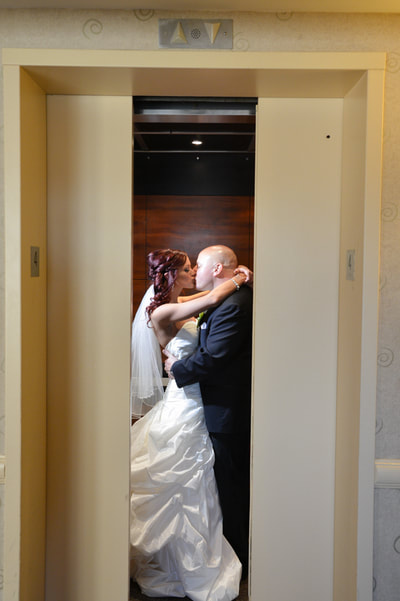 Bride and groom on elevator