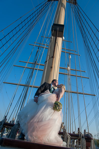 Bride and groom on boat in summer