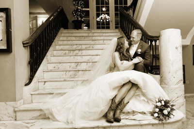 Bride and Groom sitting on steps of venue