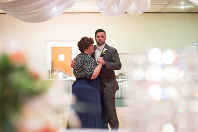 Groom and mother dancing at wedding in Bucks County PA